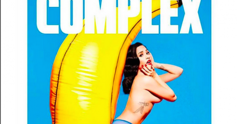 Demi Lovato goes topless, plays with a knife and blowup banana in Complex shoot