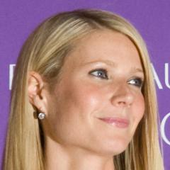 Gwyneth Paltrow shows off her slim figure in a black cut-out dress.