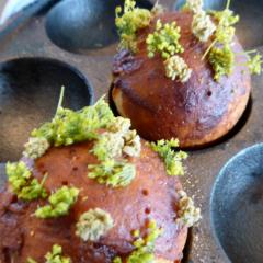 Noma's twist on a traditional Danish holiday donut (ableskiver) is to stuff it with parsley and bee larvae and top it with fermented grasshopper paste and angelica flowers.