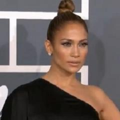 Jennifer Lopez arrives at the 2013 Grammy Awards with her Angelina leg in tow. Covering the rest of the songstress's body was a flowing Anthony Vaccarello asymmetrical gown.