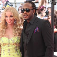 MuchMusic VJs Liz Trinnear and Tyrone 'T-RexXx' Edwards arrive at the 2012 MuchMusic Video Awards in Toronto on June 17, 2012.
